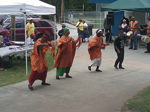 Keenagers perform an African dance