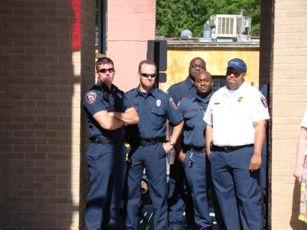 A Few of Decatur's Firefighters Observe the Ribbon Cutting