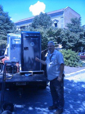 Jerry Knotts shows off the new compactors.