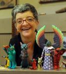 Ann VanSlyke is owner of Mingei World Arts, which is selling the collectible woodcarvings by various artists featuring different figures reading books
