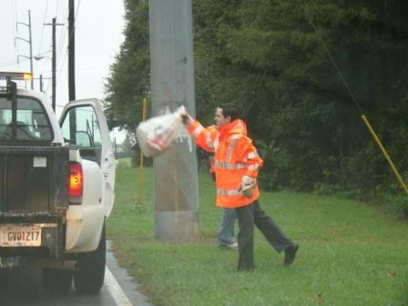 Mark caught on quickly to throwing trash in the truck!